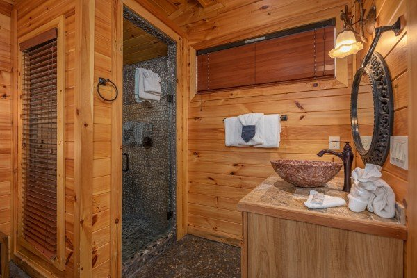 Shower and vanity in the third bedroom at La Dolce Vita, a 4 bedroom cabin rental located in Gatlinburg