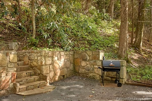 Charcoal grill in designated area at Gatlinburg Lodge, a 6-bedroom cabin rental located in Gatlinburg