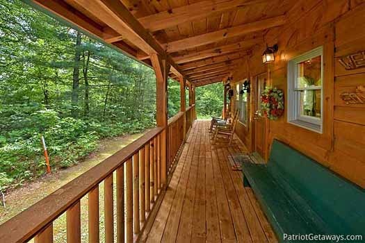 Deck rockers and bench at Fox Ridge, a 3-bedroom cabin rental located in Pigeon Forge
