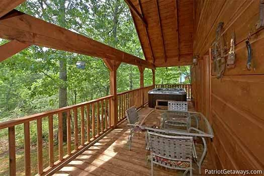 Seating on the deck at Fox Ridge, a 3-bedroom cabin rental located in Pigeon Forge