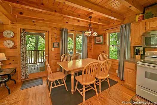 Dining table for six at Fox Ridge, a 3-bedroom cabin rental located in Pigeon Forge