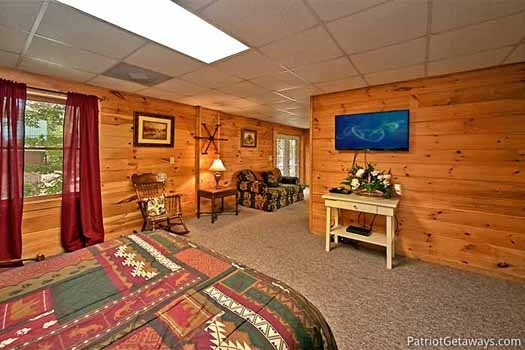 first floor bedroom connects to the game room at fox ridge a 3 bedroom cabin rental located in pigeon forge