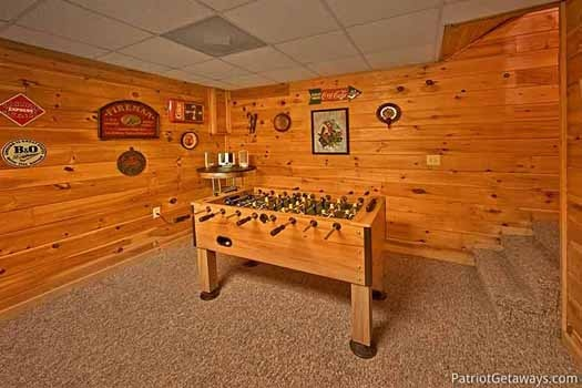 Foosball table in the game room at Fox Ridge, a 3-bedroom cabin rental located in Pigeon Forge