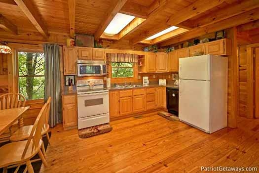 white appliances in kitchen at fox ridge a 3 bedroom cabin rental located in pigeon forge