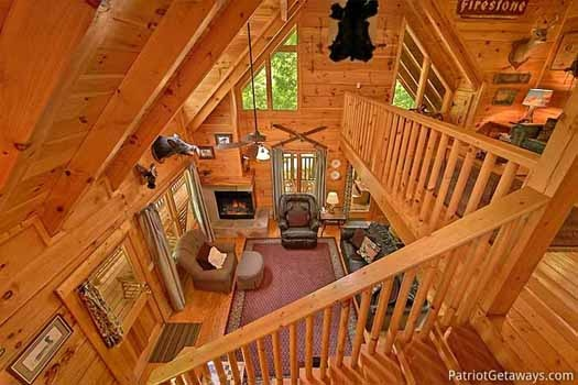 view of the living room from the loft at fox ridge a 3 bedroom cabin rental located in pigeon forge