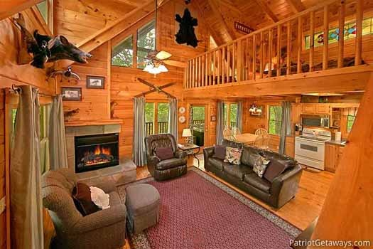 living room with fireplace at fox ridge a 3 bedroom cabin rental located in pigeon forge
