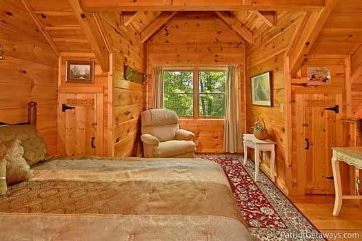 Reading nook with chair in lofted bedroom at Fox Ridge, a 3-bedroom cabin rental located in Pigeon Forge