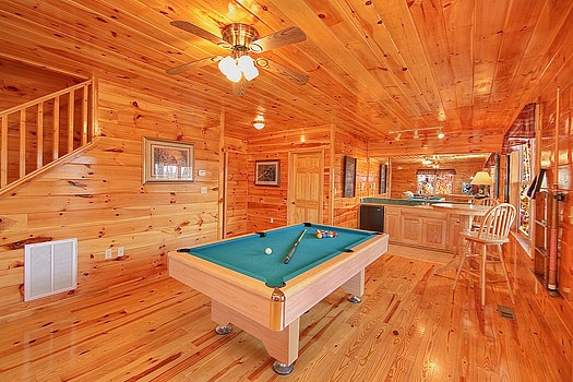 first floor game room with pool table and wet bar at hickernut lodge a 5 bedroom cabin rental located in pigeon forge