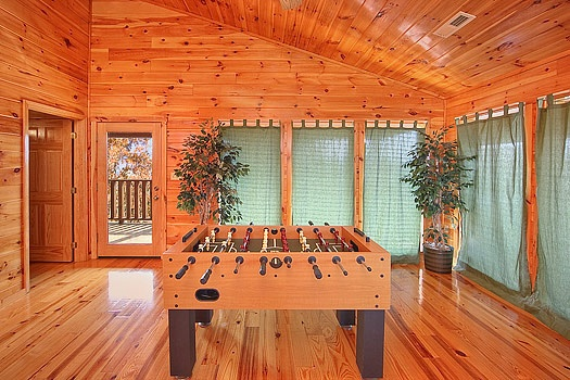 foosball table in third floor game room at hickernut lodge a 5 bedroom cabin rental located in pigeon forge