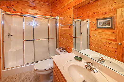 full bathroom with shower at hickernut lodge a 5 bedroom cabin rental located in pigeon forge
