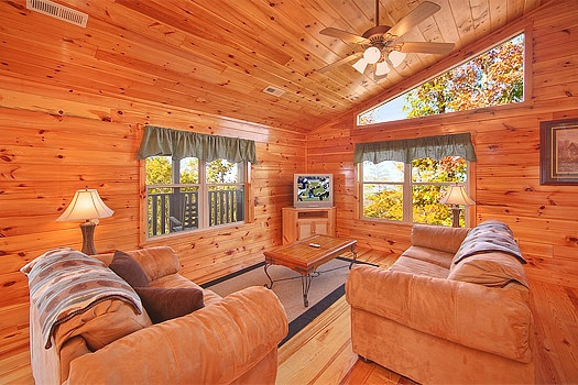 third floor game room with sofa bed at hickernut lodge a 5 bedroom cabin rental located in pigeon forge