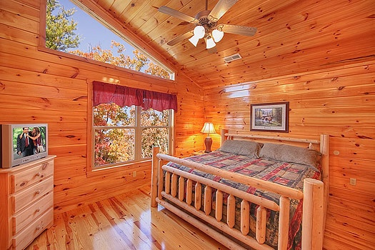 third floor bedroom with king bed at hickernut lodge a 5 bedroom cabin rental located in pigeon forge