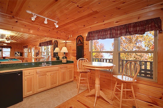 wet bar on the first floor in the game room at hickernut lodge a 5 bedroom cabin rental located in pigeon forge