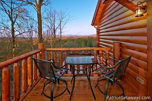 Patio table and chairs on deck at Gone to Therapy, a 2-bedroom cabin rental located in Gatlinburg