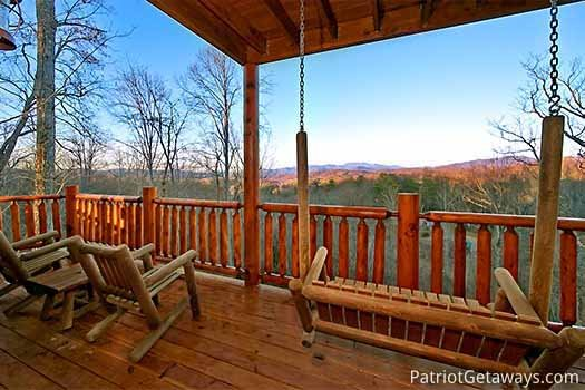 Seating on the deck facing the Smoky Mountains at Gone to Therapy, a 2-bedroom cabin rental located in Gatlinburg