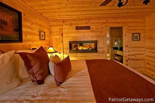 Second floor bedroom fireplace at Gone to Therapy, a 2-bedroom cabin rental located in Gatlinburg