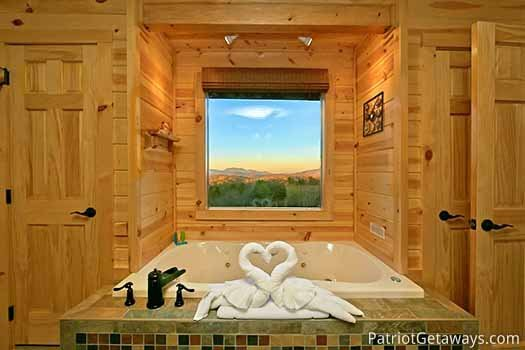 Jacuzzi tub with mountain views in second floor bedroom at Gone to Therapy, a 2-bedroom cabin rental located in Gatlinburg