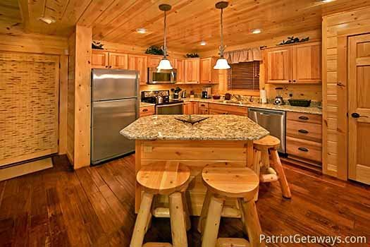 Kitchen island with barstools at Gone to Therapy, a 2-bedroom cabin rental located in Gatlinburg