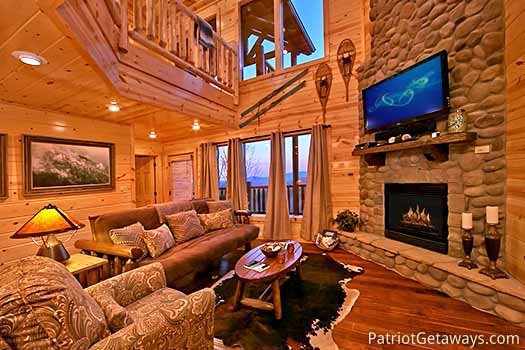 Living room with stone fireplace at Gone to Therapy, a 2-bedroom cabin rental located in Gatlinburg