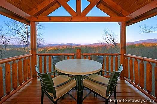 Second floor deck with table and chairs at Gone to Therapy, a 2-bedroom cabin rental located in Gatlinburg