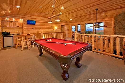 Lofted game room with pool table and wet bar at Gone to Therapy, a 2-bedroom cabin rental located in Gatlinburg