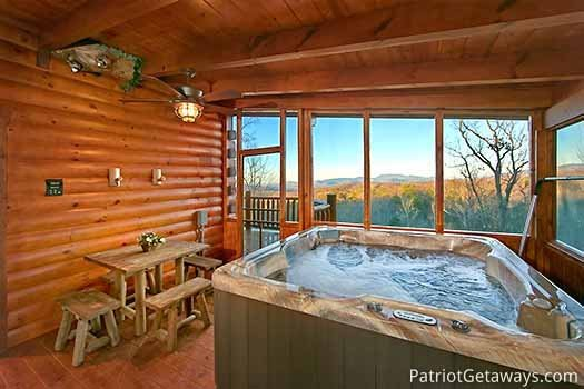Screened deck with hot tub at Gone to Therapy, a 2-bedroom cabin rental located in Gatlinburg