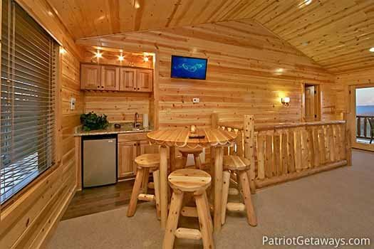 Wet bar in lofted game room at Gone to Therapy, a 2-bedroom cabin rental located in Gatlinburg