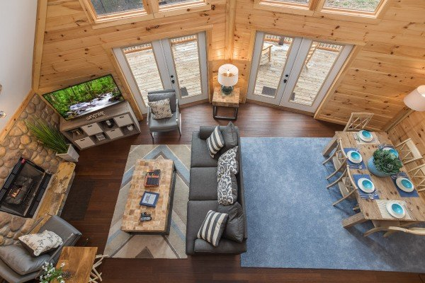 Looking down into the living room from above at Pigeon Forge Panorama, a 2 bedroom cabin rental located in Pigeon Forge