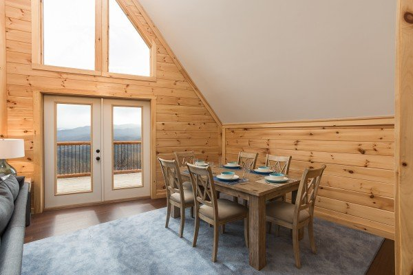 Dining table with seating for six in the main room at Pigeon Forge Panorama, a 2 bedroom cabin rental located in Pigeon Forge