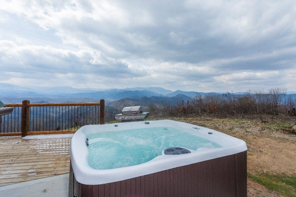 Hot tub on a patio at Pigeon Forge Panorama, a 2 bedroom cabin rental located in Pigeon Forge