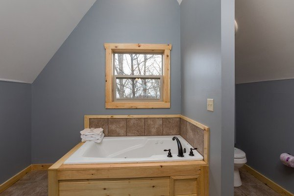 Jacuzzi in the loft bathroom at Pigeon Forge Panorama, a 2 bedroom cabin rental located in Pigeon Forge