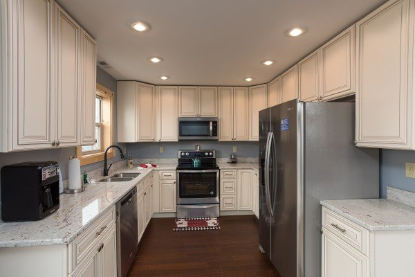 Kitchen with stainless appliances at Pigeon Forge Panorama, a 2 bedroom cabin rental located in Pigeon Forge