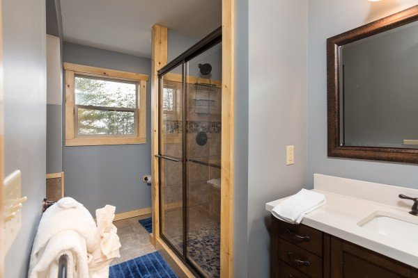 En suite bath with a walk in shower at Pigeon Forge Panorama, a 2 bedroom cabin rental located in Pigeon Forge