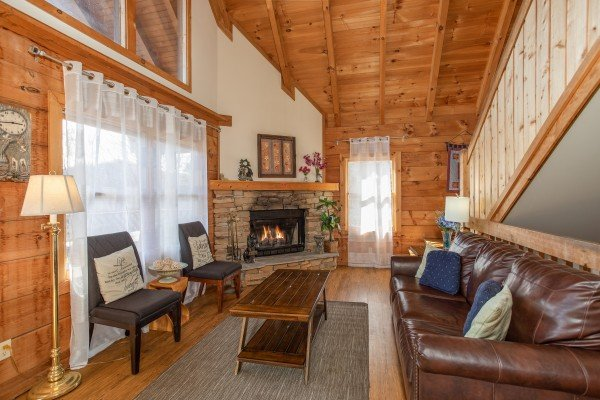 Living room with fireplace at Brink of Heaven, a 2-bedroom cabin rental located in Gatlinburg