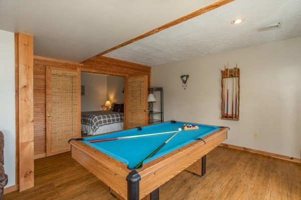 Pool table in the game room at Brink of Heaven, a 2-bedroom cabin rental located in Gatlinburg