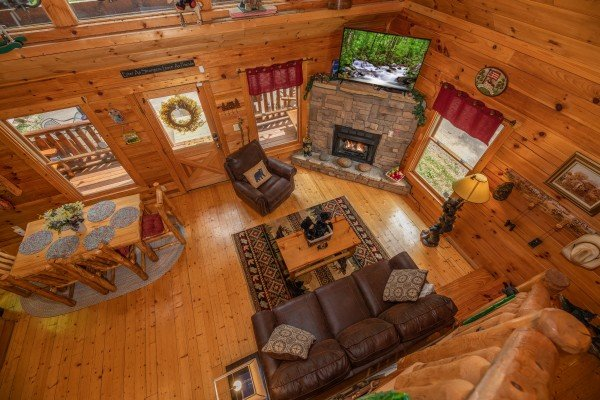 Looking down into the living and dining rooms at Sweet Serenity, a 2 bedroom cabin rental located in Gatlinburg