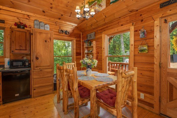 Dining table for six at Sweet Serenity, a 2 bedroom cabin rental located in Gatlinburg