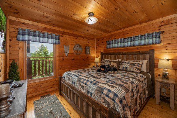 Bedroom with a king bed at Sweet Serenity, a 2 bedroom cabin rental located in Gatlinburg