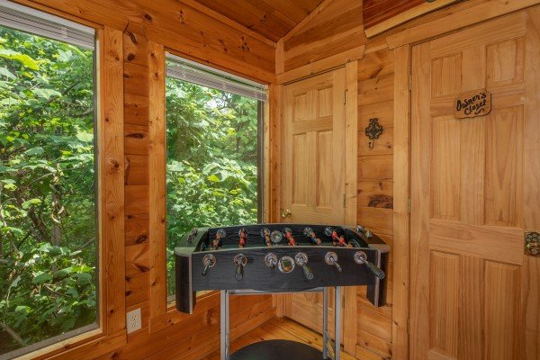 Foosball table at Sweet Serenity, a 2 bedroom cabin rental located in Gatlinburg
