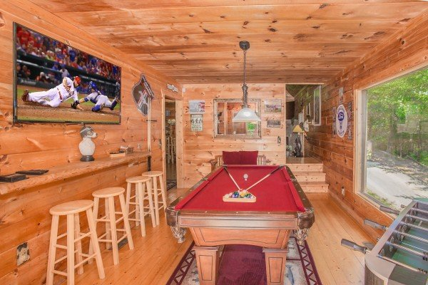 Game room with foosball and pool at Sweet Serenity, a 2 bedroom cabin rental located in Gatlinburg