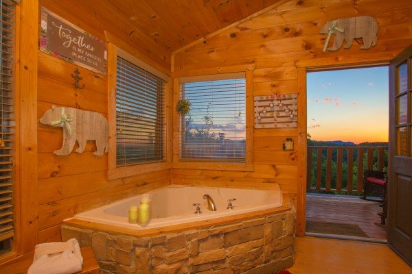 Corner jacuzzi with sunset at Sweet Serenity, a 2 bedroom cabin rental located in Gatlinburg