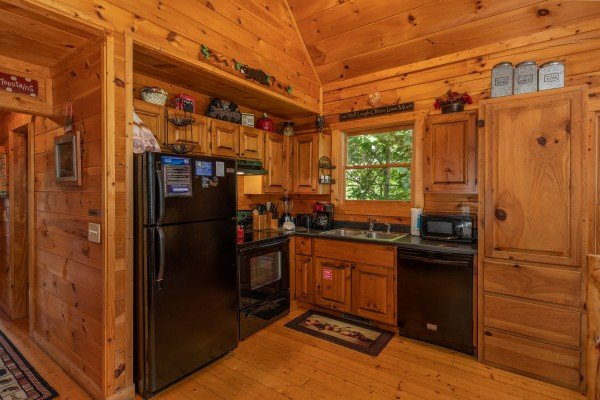 Kitchen with black appliances at Sweet Serenity, a 2 bedroom cabin rental located in Gatlinburg