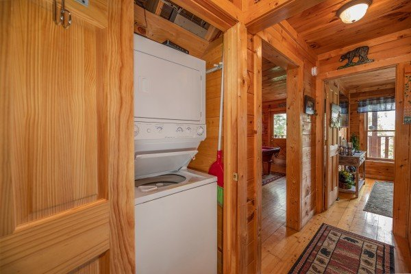 Stacked washer and dryer at Sweet Serenity, a 2 bedroom cabin rental located in Gatlinburg