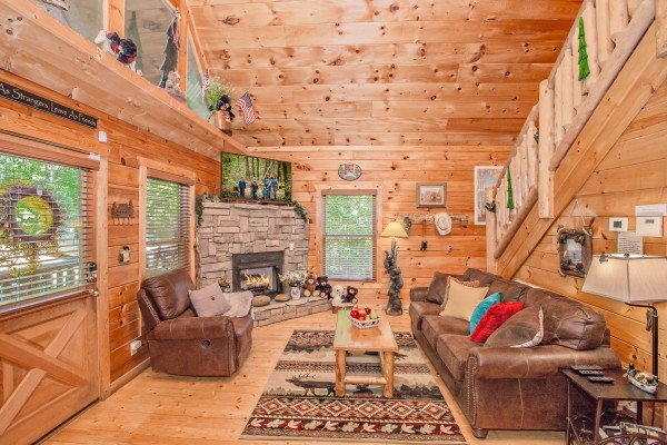 Living room with fireplace, sofa, and recliner at Sweet Serenity, a 2 bedroom cabin rental located in Gatlinburg
