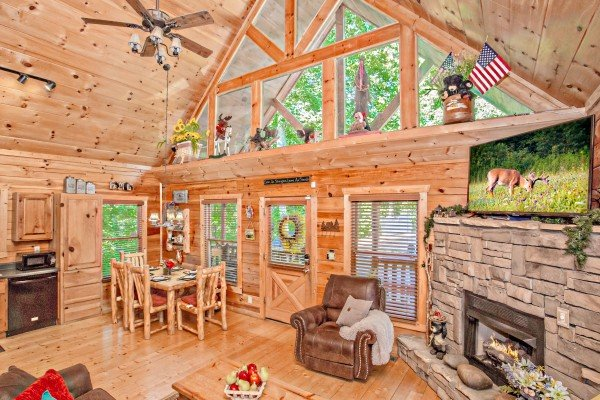 Main living area with dining, kitchen, and living room at Sweet Serenity, a 2 bedroom cabin rental located in Gatlinburg