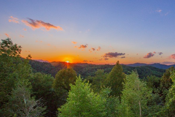Vibrant sunset over the mountains at Sweet Serenity, a 2 bedroom cabin rental located in Gatlinburg