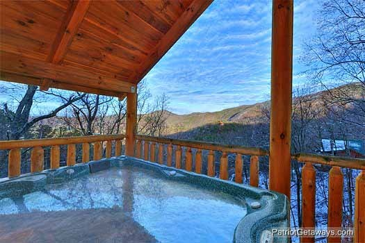 Covered hot tub at Scenic Mountain View, a 1 bedroom cabin rental located in Pigeon Forge