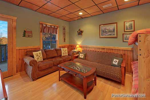 Game room with futon at Scenic Mountain View, a 1 bedroom cabin rental located in Pigeon Forge