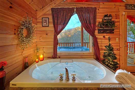jacuzzi tub in bedroom at scenic mountain view a 1 bedroom cabin rental located in pigeon forge