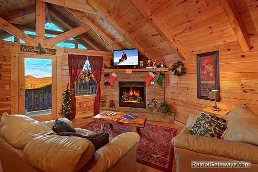 living room with fireplace at scenic mountain view a 1 bedroom cabin rental located in pigeon forge